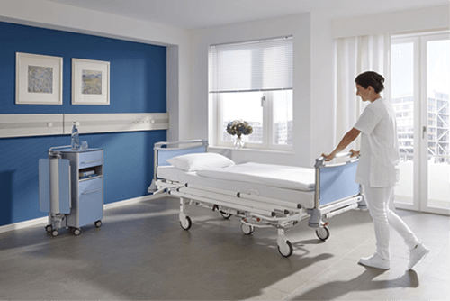 a nurse holding the patient bed in the room