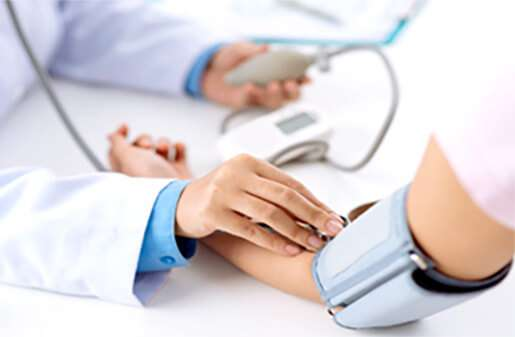 a Nurse taking the blood pressure of a patient