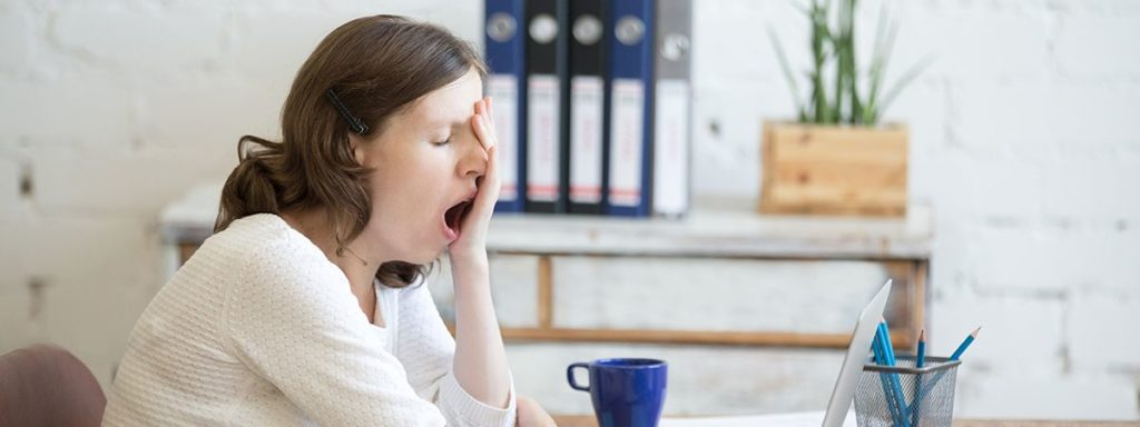 woman yawning cause of adrenal fatigue