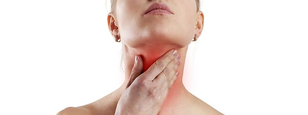 woman heads up and holding her neck to check her thyroid glands