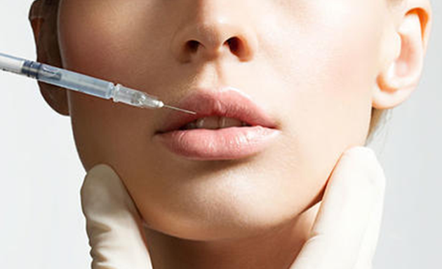 doctor used injection to the lips of a woman patient